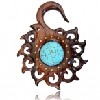 Narra wood piercing with brass and turquoise inlay.