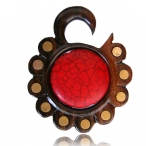 Narra wood piercing with brass and red stone inlay.