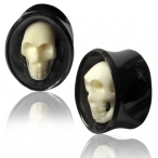 bone skull set in a oval horn plug